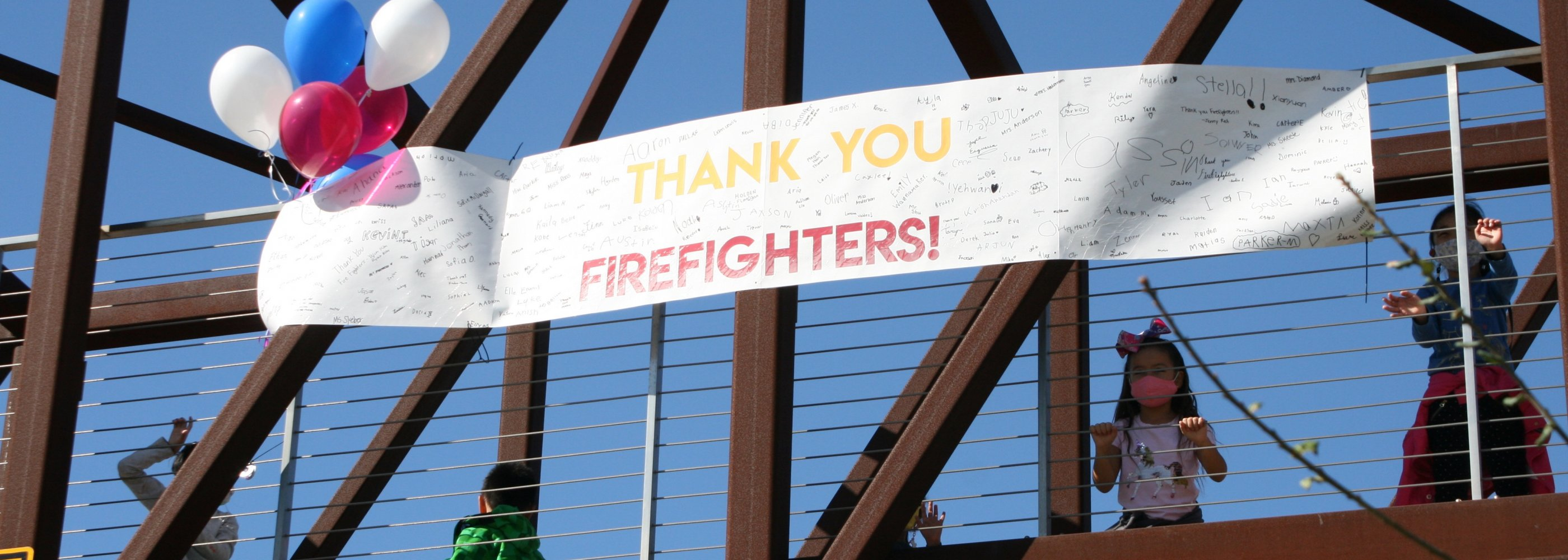 Thank you sign to fire fighters on bridge